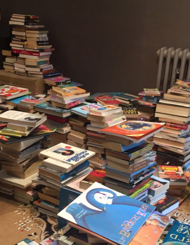 What do 2,500 books look like you might wonder? It looks like pure and utter chaos when they first arrive.