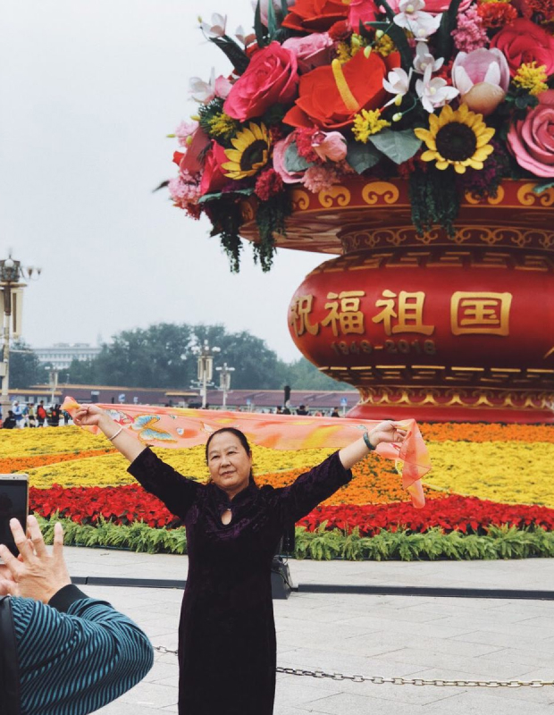 And this aunty super loving her own pose in front of a giant flower exhibit at Tiananmen Square.