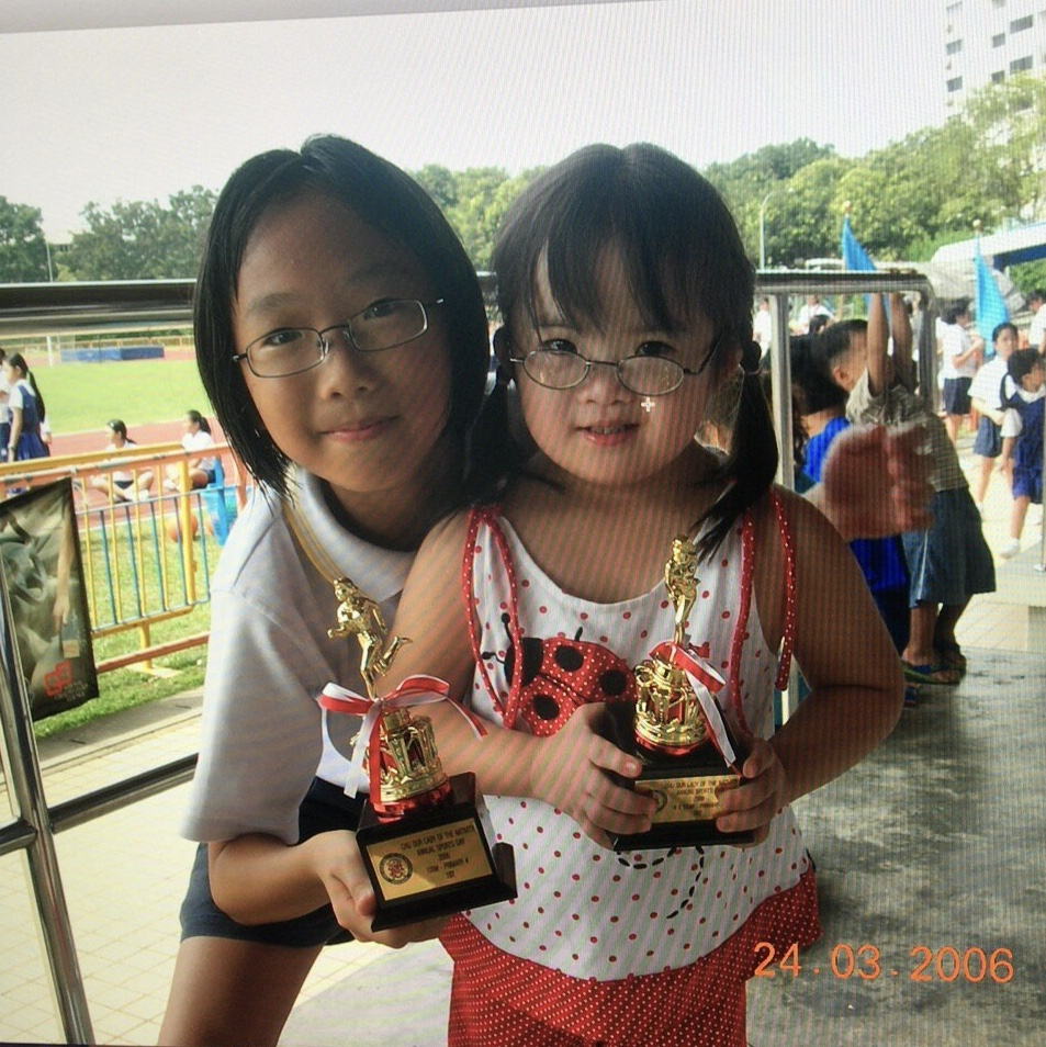With my sister at a primary school sports day, 2007.