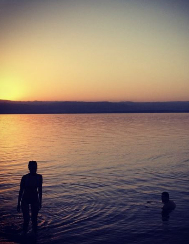 Floating in the Dead Sea at sunset in Jordan.