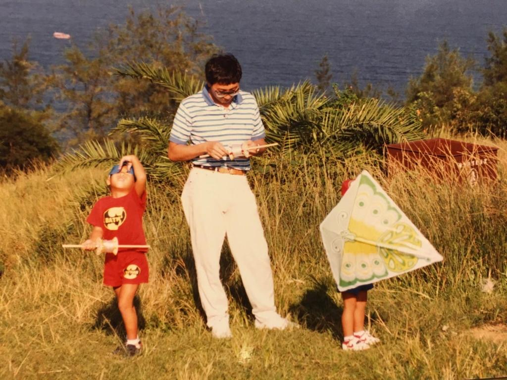 Kite flying with my sons, who were two and four years old.
