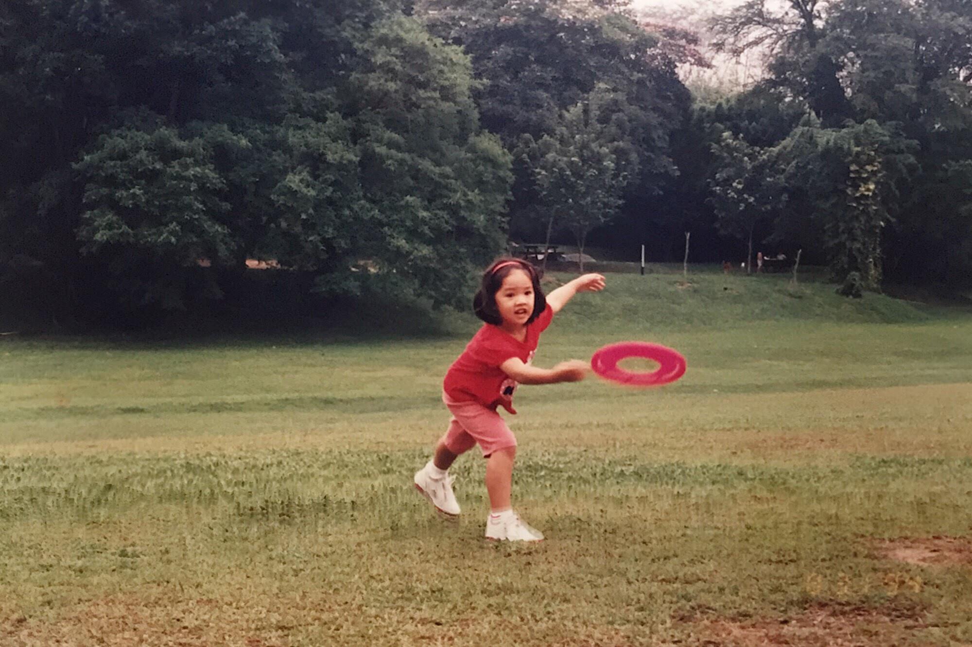 Playing in Lake Gardens, Kuala Lumpur, when I was five.