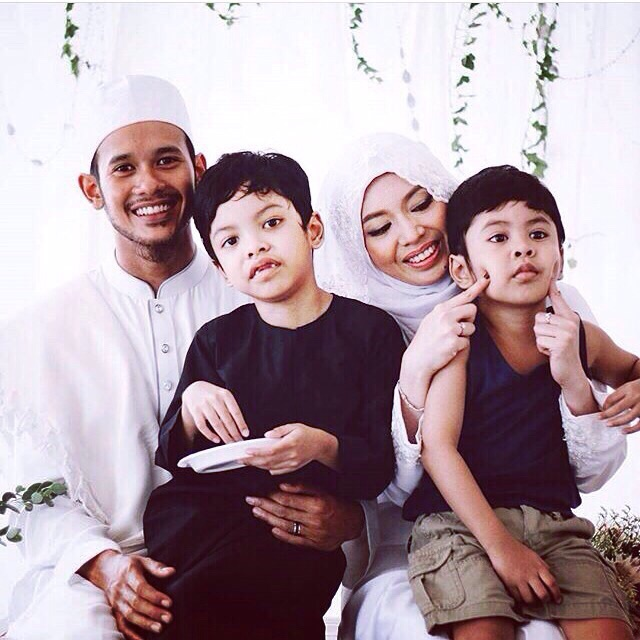 My husband and I with Aryan and Aniq on our wedding day.