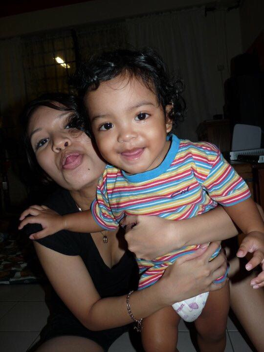 Myself as a young mum with Aryan. Everyone loved his curly hair.